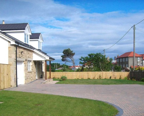 This was a new build. We provided a complete landscaping service including drainage, large driveway, fencing and turfing.