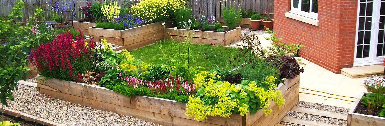 Raised Flowerbeds in Gravel Garden