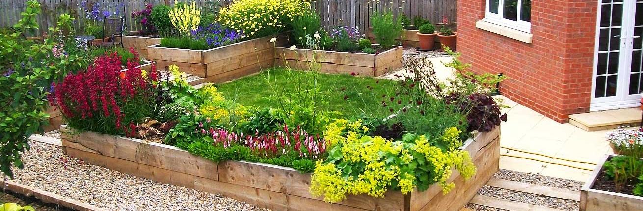 Raised Flowerbeds in Gravel Garden