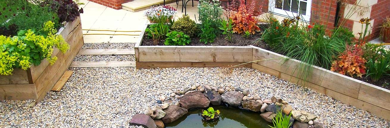 Landscaped Garden with Raised Flowerbeds and Pond
