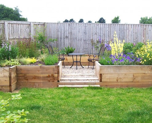 Beautiful garden created from scratch with the use of raised flower beds .