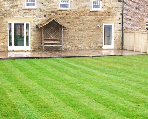 After picture of a new home built on land that had previously been used as an opencast coal mine, now fully landscaped.