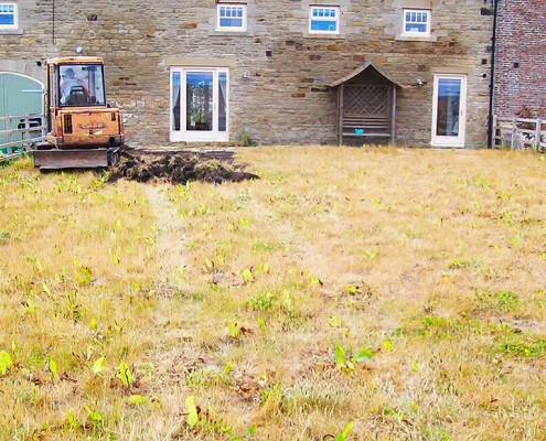 Before picture of a new home built on land that had previously been used as an opencast coal mine.